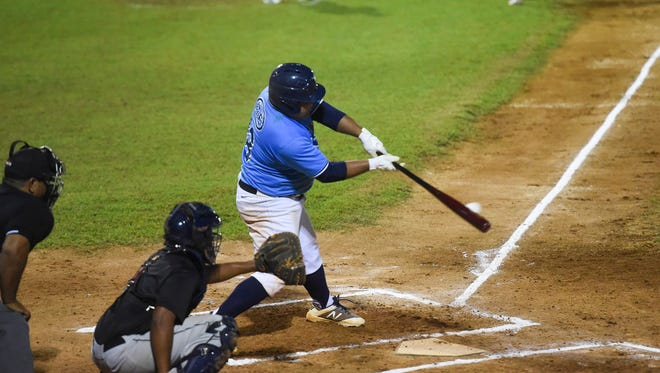 In this Jun 29 file photo, the IT&E Rays' Dom Cruz connects on a pitch against the Yona RedHawks during a Guam Major League Baseball game at Paseo Stadium. The Rays are the top seed in the playoffs.