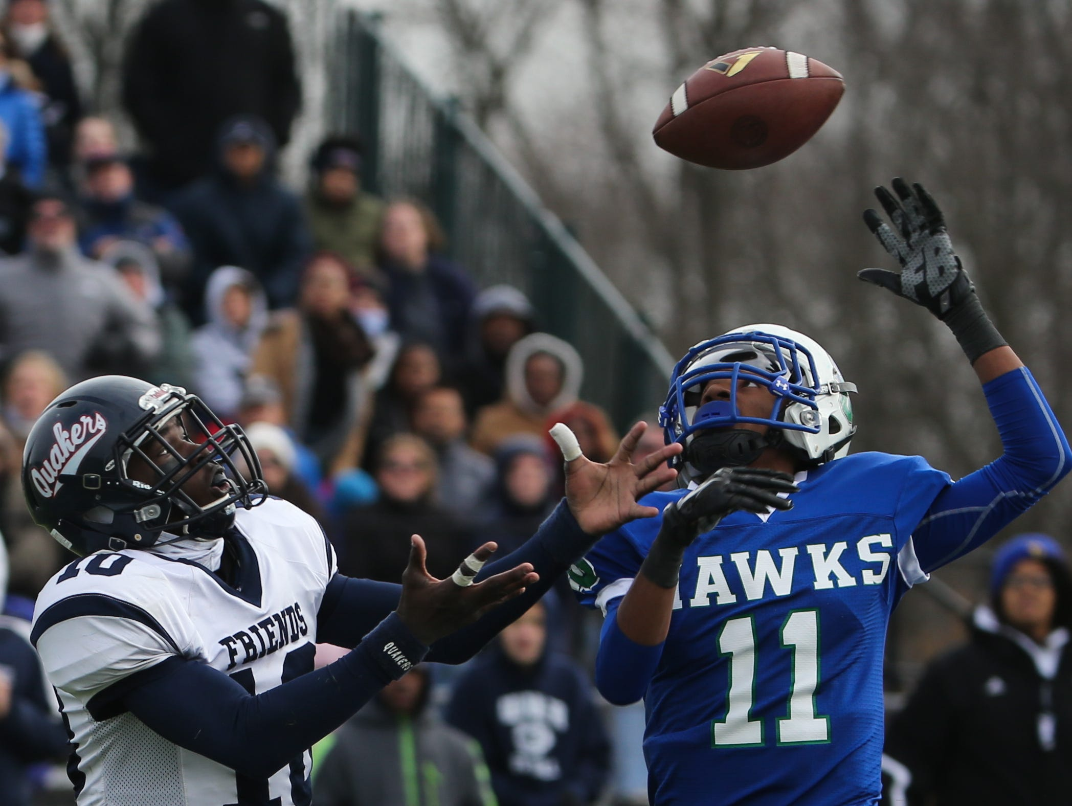 Friends halfback Quinten McAbee and St. Georges defensive back Robert Shorts make a play on a Justin Beneck pass in the third quarter. Wilmington Friends advances to the DIAA Division II state finals with a 20-6 win over St. Georges Saturday.