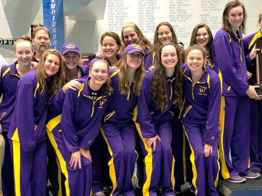 Molly Craig, front center, poses with her teammates