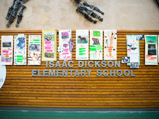 Posters describing the different state animals hang on the wall of Isaac Dickson Elementary.
