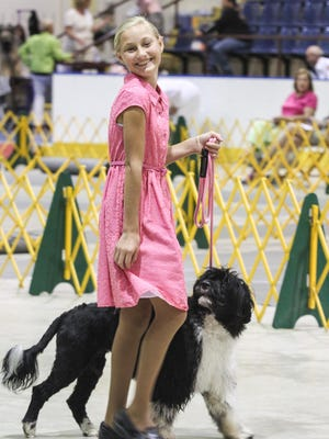Junior handler Faith Rogers walks Winnie, a Portuguese Water Dog.