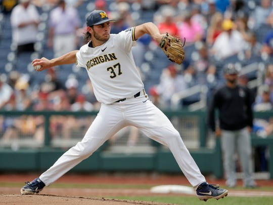 Michigan starting pitcher Karl Kauffmann (37) works against Texas Tech in the first inning of an NCAA College World Series baseball game in Omaha, Neb., Friday, June 21, 2019. (AP Photo/Nati Harnik)