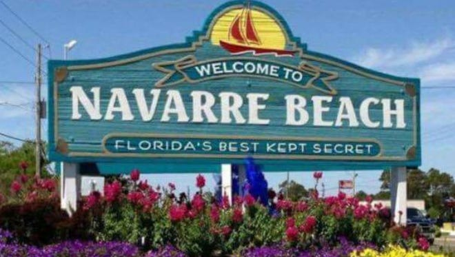 "The original ""Welcome to Navarre Beach"" sign at the entrance to the beach causeway on U.S. 98. Residents are planning a protest on Friday, June 9, 2017, to bring back the sign."