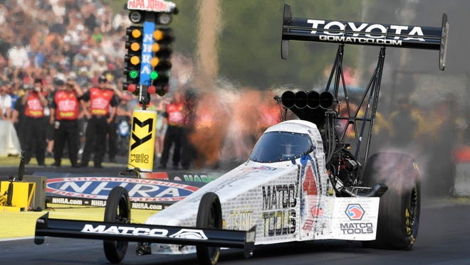 Antron Brown drives during Top Fuel qualifying at the NHRA Northwest Nationals drag races at Pacific Raceways in Kent, Wash. Brown ran a 3.735-second pass at 329.10 mph to take the top spot in qualifications.