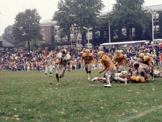 Guy Albanese turning the corner in an Oct. 11, 1975 game for Nutley against archrival Belleville in a downpour at the Oval. The game ended in a scoreless tie.