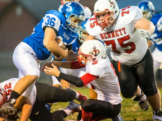 Stephen Decatur running back Alan Means (36) rushes against James M. Bennett on Friday night at Seahawk Stadium in Berlin.