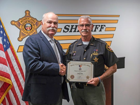 Upgrading security is a focus of a school safety levy that voters in five of Butler County's 10 districts are being asked to approve Nov. 6, 2018. Opposed to the levy is Butler County Sheriff Richard Jones, left, shown here with Doug Hale Officer of the Year. He is assigned as a school resource officer at Lakota East High School.