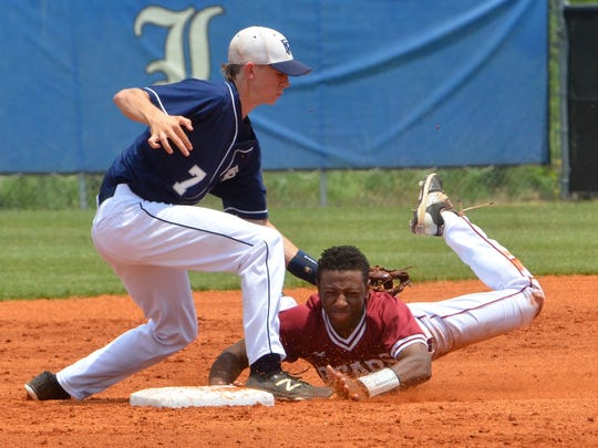 FRA shortstop Ponder Thurman applies the tag to Ezell-Harding's