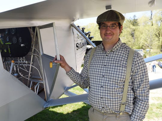 Michael DiGiacomio, museum president at the Old Rhinebeck Aerodrome in Red Hook, opens the door to the cockpit of the replica of the Spirit of St. Louis.