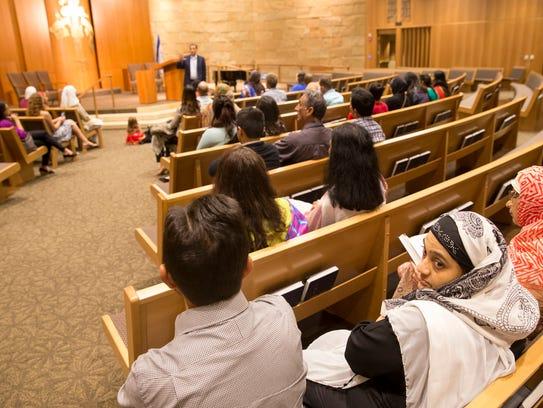 Senior Rabbi Brett Krichiver gives a tour to visiting