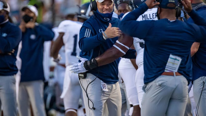 Georgia Southern coach Chad Lunsford smiles during the 35-30 win over host ULM on Saturday night in Monroe, Louisiana.