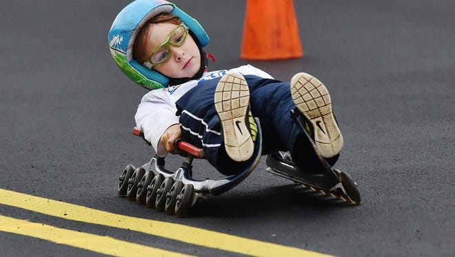 Braden Broadbent, 9, of Remsen, rides a luge sled down a hill Saturday, September 14, 2019 in Utica. White Castle and USA Luge bring the 2019 Slider Search to cites across the United Stated to introduce youth to luge and look for next generation of USA Luge team members and Olympians.