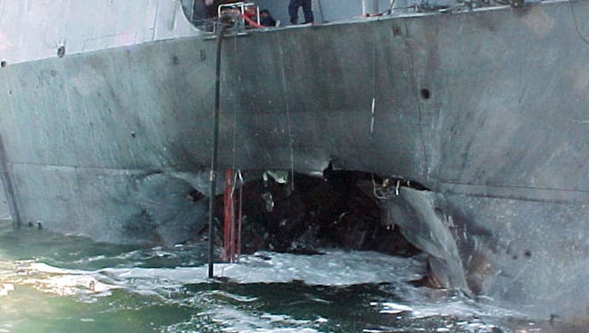 This image provided by the U.S. Navy shows damage sustained on the USS Cole after a suspected terrorist bomb exploded during a refueling operation in the port of Aden, Yemen, Oct. 12, 2000.