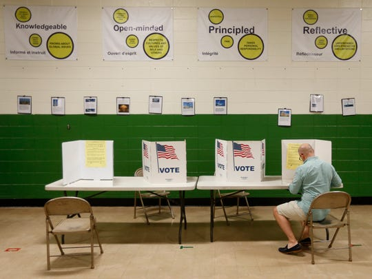Voters cast their ballots in the presidential primary election on Tuesday, March 15, 2016.