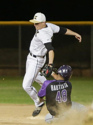 Shadow Hills' Chucky Batista slides into second against Xavier Prep on Tuesday.