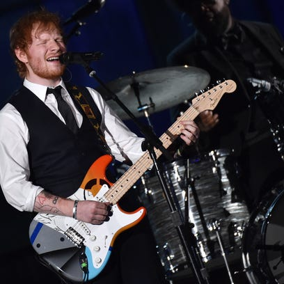 Ed Sheeran performs at the 57th annual Grammy Awards