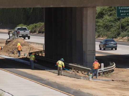 Construction crews pour concrete foundations on Tuesday,