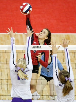 Newman Catholic's Rylie Vaughn spikes the ball against Clayton at the Division 4 semifinal at the WIAA Girls State Volleyball Tournament last Friday at the Resch Center. The Cardinals senior made her commitment to the University of Wisconsin-Milwaukee official Wednesday.