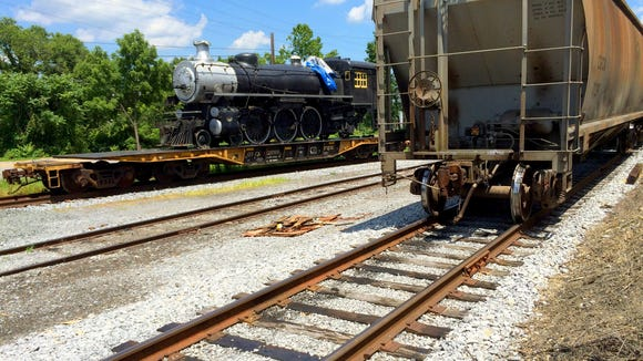 Steam locomotive 1286 sits loaded and made ready to depart Staunton one last time. It rests on a a railway car at Shenandoah Valley Railroad in Staunton on Thursday, July 23, 2015. Once owned by Jack Showalter who died in November 2014, his daughter, Sally Kammauff, is helping oversee the preparations for the departure of the train and it's sister locomotive, 1238, for their trek north to Canada . Originally, both trains were part of the Canadian Pacific Railroad.
