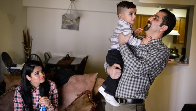 Mohammed Berwari spends time with his wife, Jiman Mousa, and his son, Aral Berwari, 17 months old, at their home in Nashville on March 23, 2017. Berwari moved to Nashville in 2012 after working with the U.S. military in Iraq.