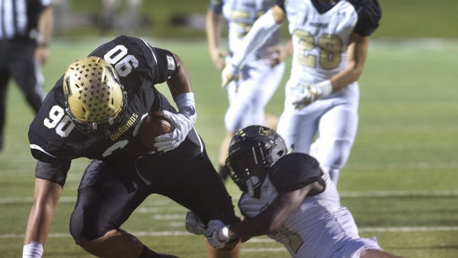 Nellie Doneva/Reporter-News Abilene High's Coy McMillon (90) is tackled by Fossil Ridge's Elijah Hicks during the Eagles' win Friday.