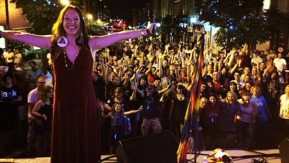 Julie Cymek of Sweet Leda in front of the Ladybug crowd