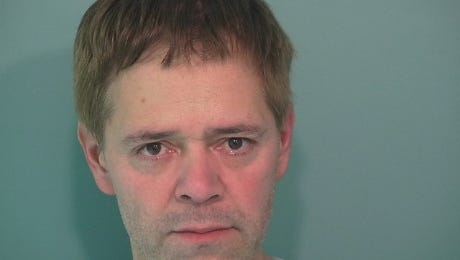 Kevin Acup, 51, of Salem, was arrested for allegedly dragging a police officer 15 feet with a stolen car.