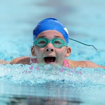 Kara Vandeyacht of the Fox Cities YMCA Swim Team gets a breath as she competes in the 50 LC Meter Butterfly as the 17th Annual Bird Bath Invitational swim meet takes place at Erb Pool in Appleton, Saturday, July 11.