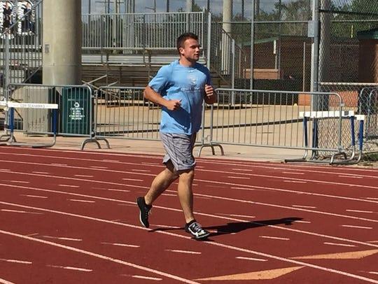 CSN sprinter Alex Murphey jogs back to the starting