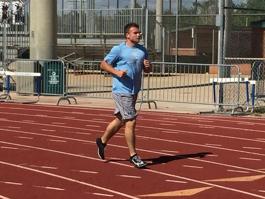 CSN sprinter Alex Murphey jogs back to the starting line after completing a drill during Tuesday afternoon's practice.