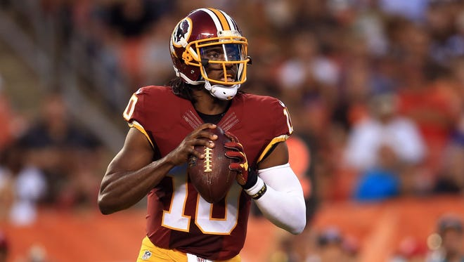 Washington Redskins quarterback Robert Griffin III (10) looks to pass during the first quarter of preseason NFL football game against the Cleveland Browns at FirstEnergy Stadium.