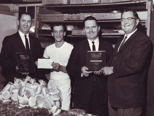 Former Distelfink owner Cecil Sandoe, second from right,