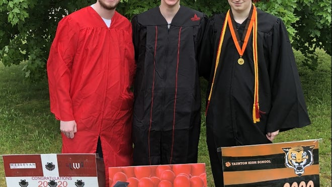 Taunton brothers, from left to right, Andrew Callahan, Quinton Callahan and Matthew Callahan stand next to their graduating schools