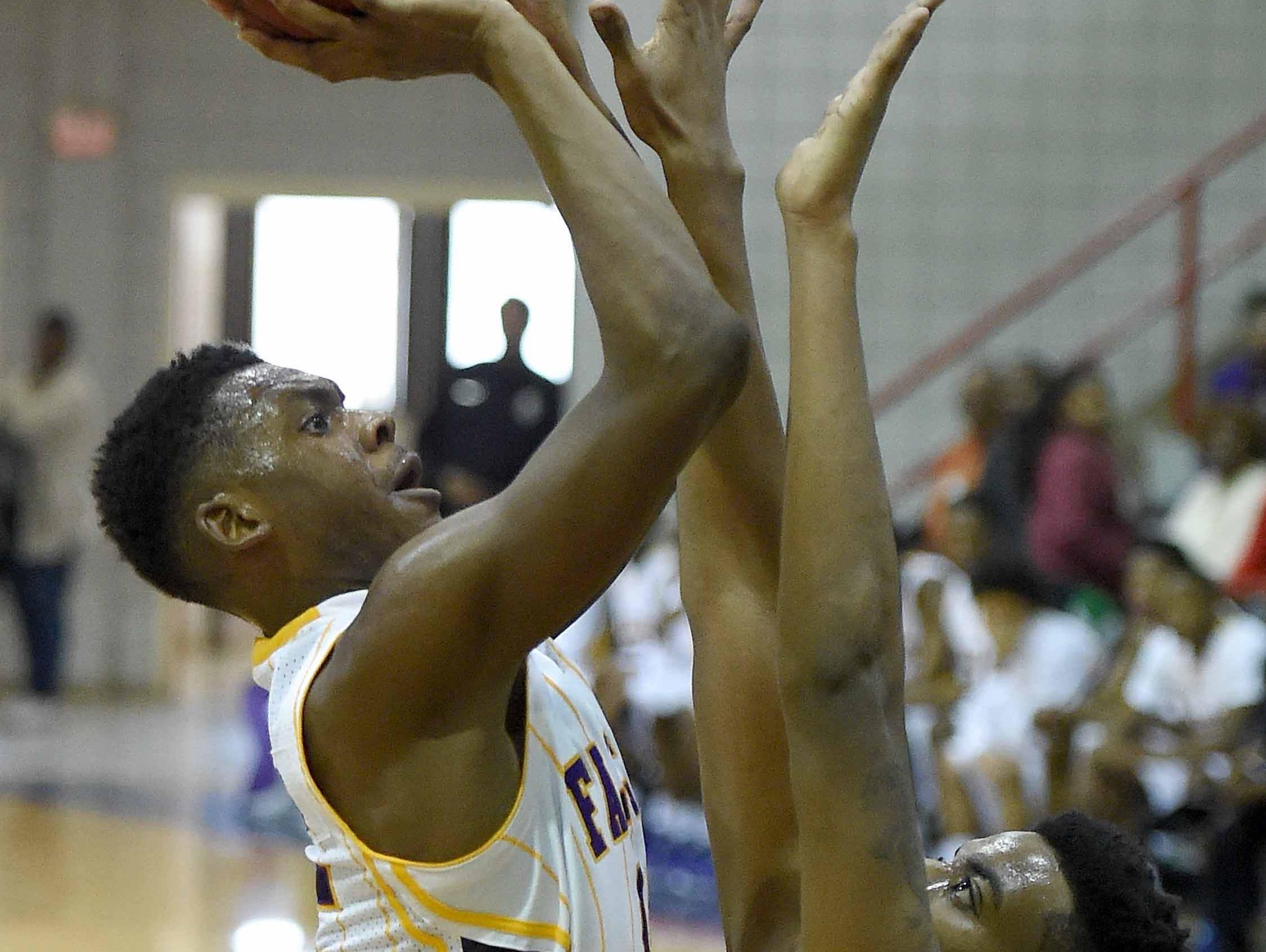 Columbus Falcon sophomore Robert Woodard, Jr. shoots over Provine's Eddie Galloway on Saturday, November 21, 2015, in the Orsmond Jordan Showcase basketball tournament at Forest Hill High School in Jackson, Miss.
