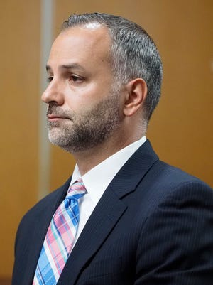 Former Edison Police Officer Michael Dotro appears in Middlesex County Superior Court for a pre-trial hearing in New Brunswick in July.