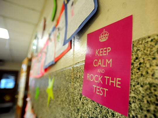 A motivational poster hangs outside of a fourth grade classroom as students take the LEAP test in 2013.