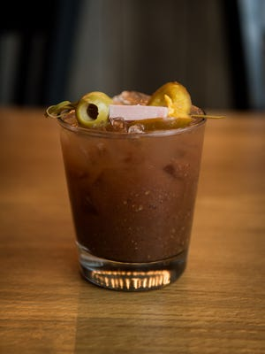 The Bloody Mary at Polpettina is made with balsamic vinegar. Drinking vinegars, also known as shrubs, are becoming popular in the suburbs.