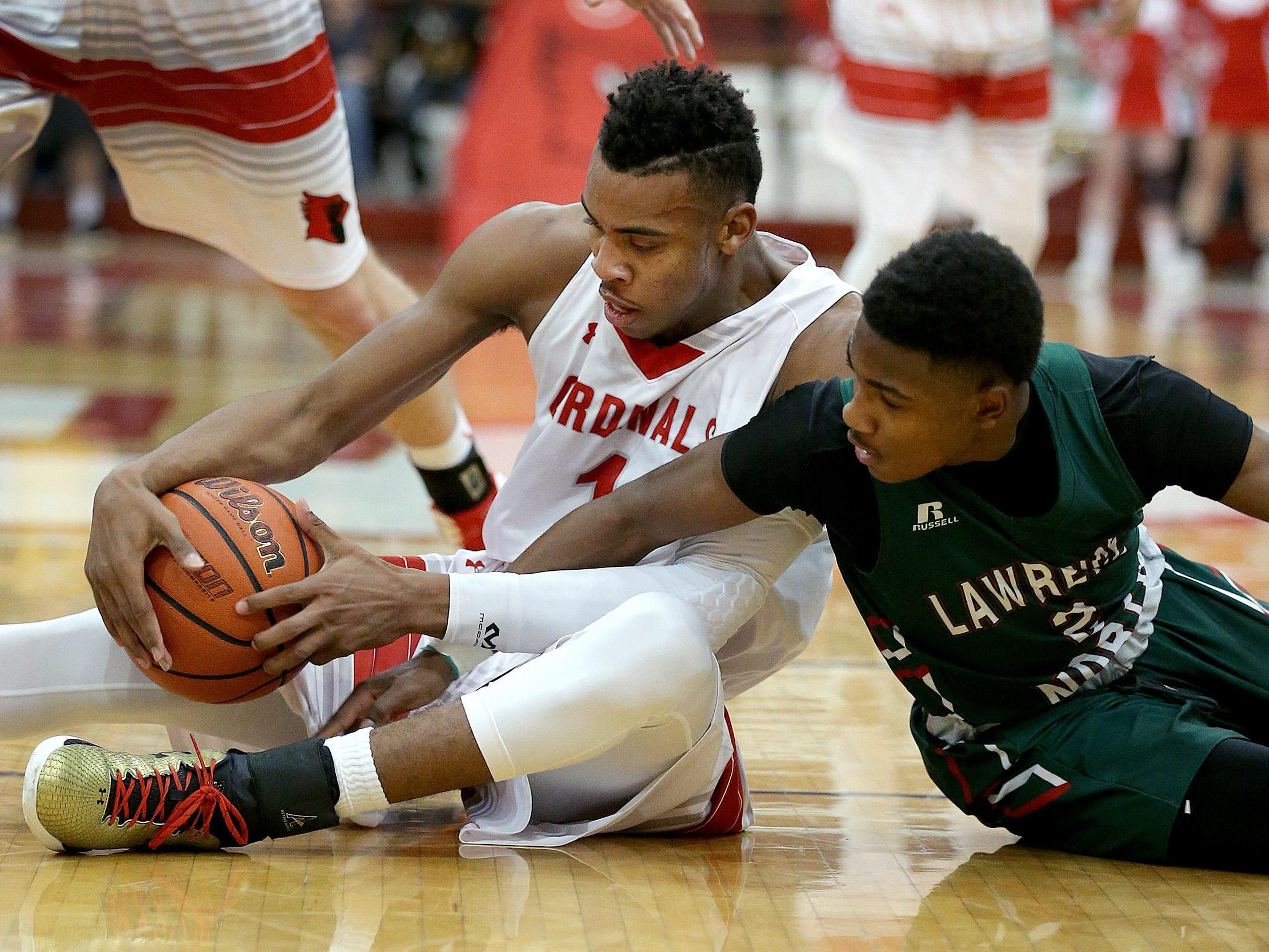 SouthportÕs Paul Scruggs (1) fights for a loose ball with Lawrence NorthÕs Antwaan Cushingberry (2) in the second half of their game Wednesday, Jan 20, 2016, evening at Southport High School. Lawrence North defeated Southport 46-41.