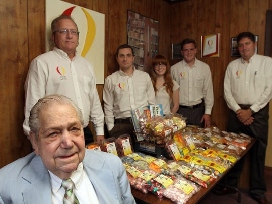 """George Erickson Sr. (seated), co-founder and chairman of the Rayge Candy Co. in Brick, is shown with other family members who work for the firm (from left): son and vice president Thomas Erickson, grandson Philip Erickson, granddaughter Katherine Erickson, grandson George """"Vic"""" Erickson III and son and president George Erickson Jr."""