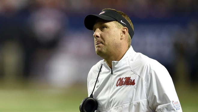 Hugh Freeze saw his offense struggling with penalties and turnovers in the first half.