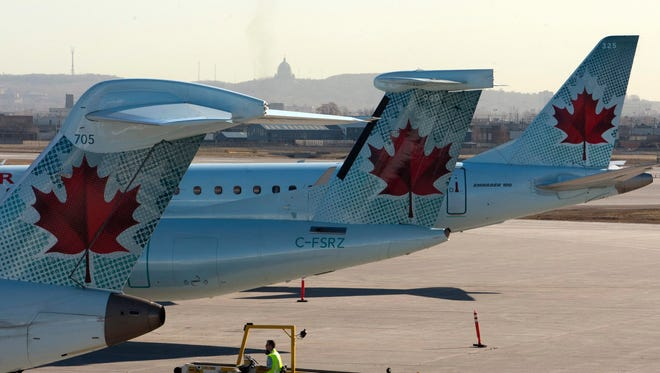 Air Canada planes at Montreal's Pierre Trudeau International Airport on March 23, 2012.