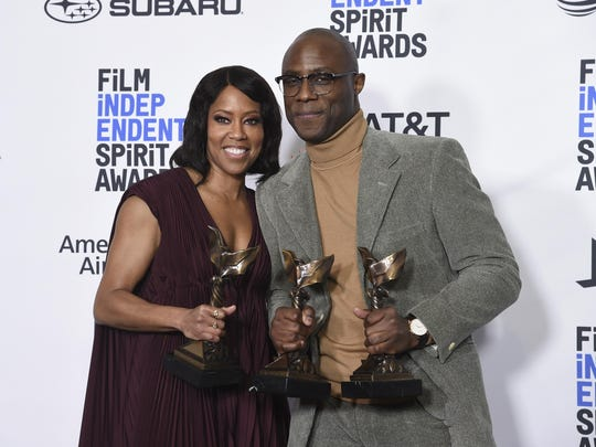 "Regina King, winner of the award for best supporting female, left, and Barry Jenkins, winner of best director and best feature, all for ""If Beale Street Could Talk,"" pose in the press room at the 34th Film Independent Spirit Awards on Saturday, Feb. 23, 2019."