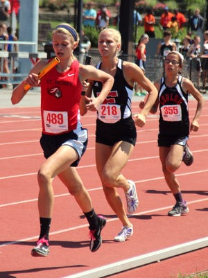 St. Henry freshman Sam Hentz helped the Crusaders win the 4x800 at the Class A state track meet last spring in Louisville.
