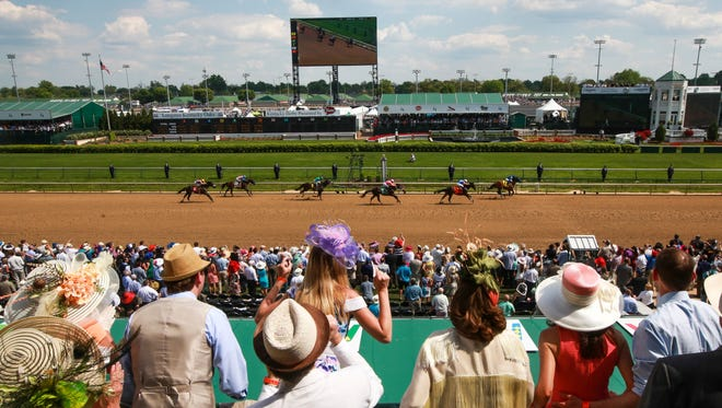 Fans cheer at the finish line during the 81st Running of the Churchill Downs on Saturday. May 2, 2015