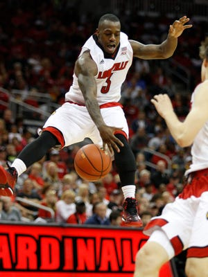 Louisville's Chris Jones drives into the paint in the second half of the U of L scrimmage at the KFC Yum! Center.October 19, 2014