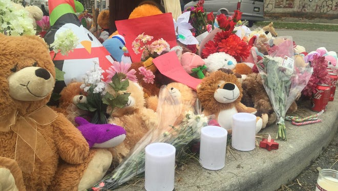 A memorial at the corner of South C Street and Franklin Street for the three Flores-Ortiz children.