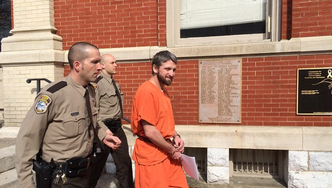 """Make sure to get my good side,"" Daniel Zawhorodny said Friday as he was led away from the Augusta County Courthouse."