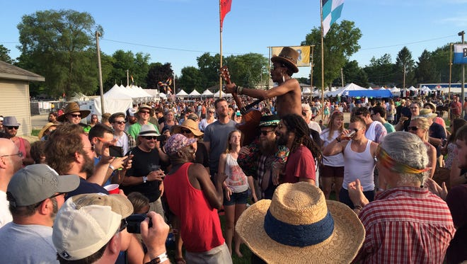 The Very Best performing in the crowd at Waverly's Gentleman of the Road stopover.