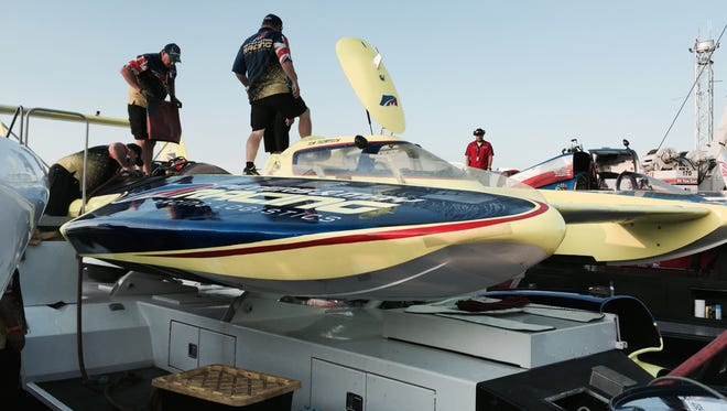 Crew prepare unlimited hydroplanes on the Detroit River Saturday morning for testing.