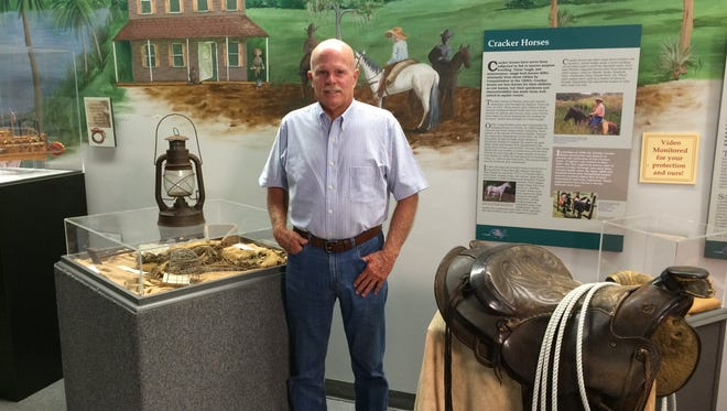 "Local author William Culyer Hall enjoys the Cracker Cowmen exhibit at the Brevard Museum of History and Natural Science. Hall's new novel about a Florida pioneer family is called ""Florida Boy."""